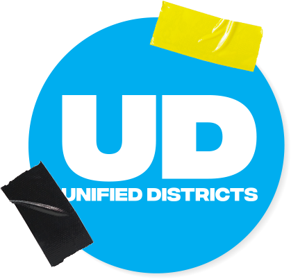 Unified Districts's logo as a sky blue button held up by yellow and black tape